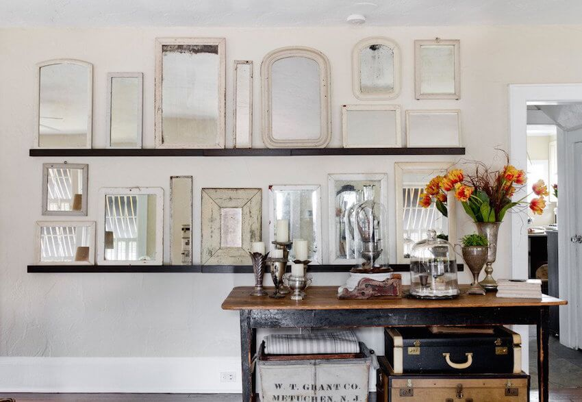 Create a panel of mirrors using different sizes and frames.