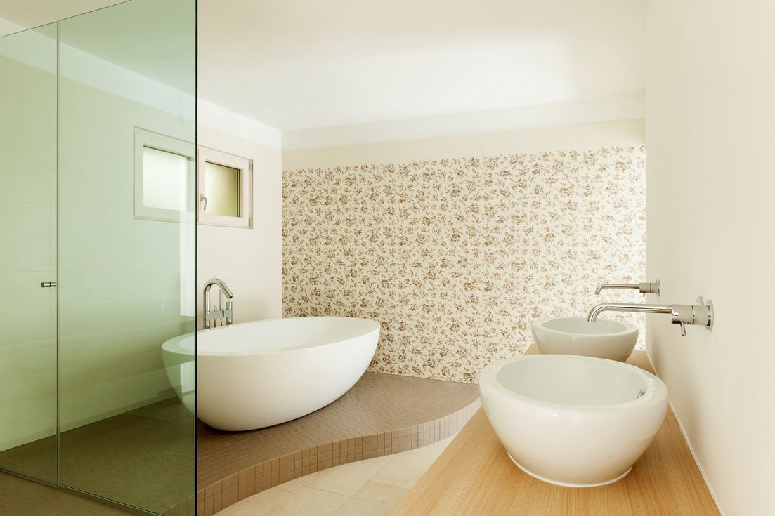 Freestanding tubs provide the feel of being at a spa.