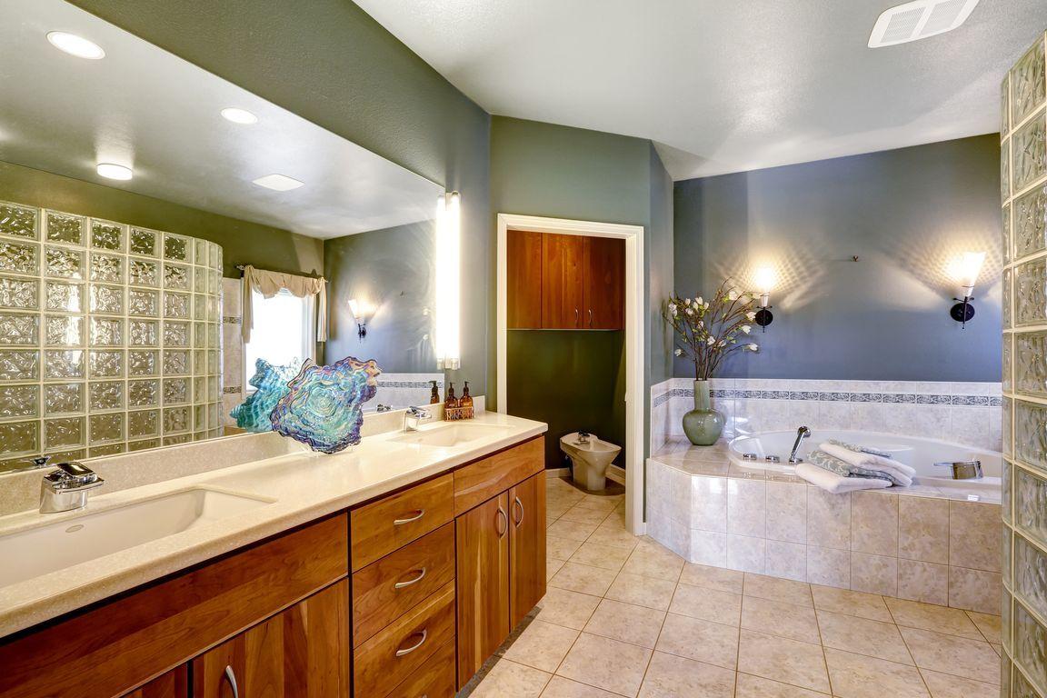 Use energy-efficient lighting fixtures in your bathroom.