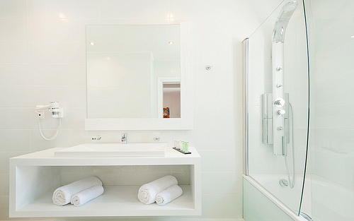 Choosing the right lighting can make your cozy bathroom feel bigger.