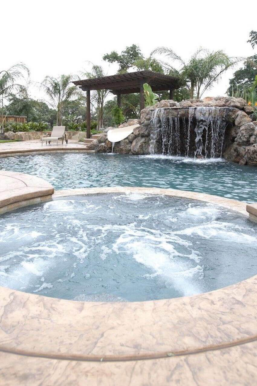Cement in ground swimming pool with a completely custom design