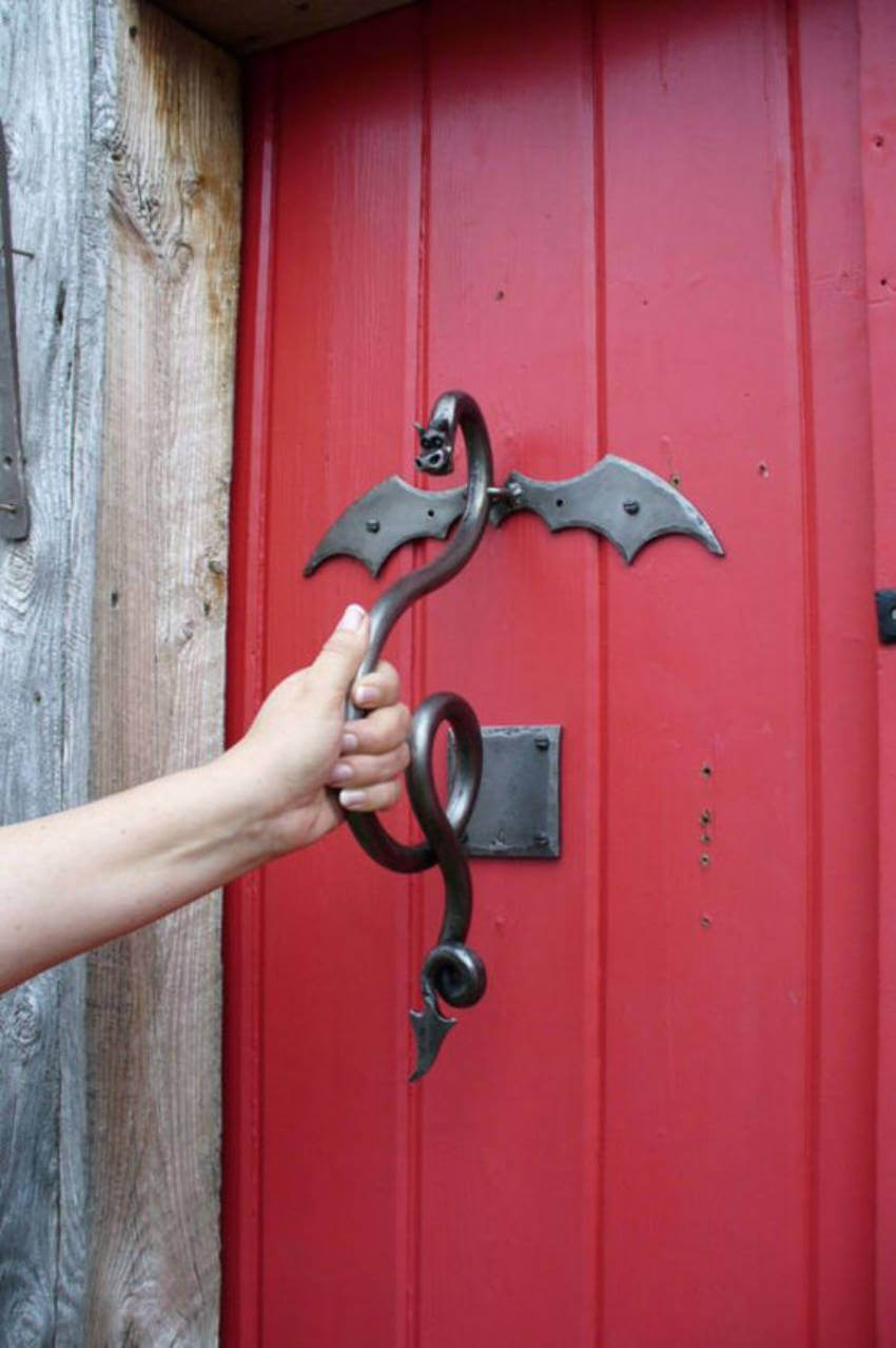 A dragon door knocker is a great way to greet the guests.