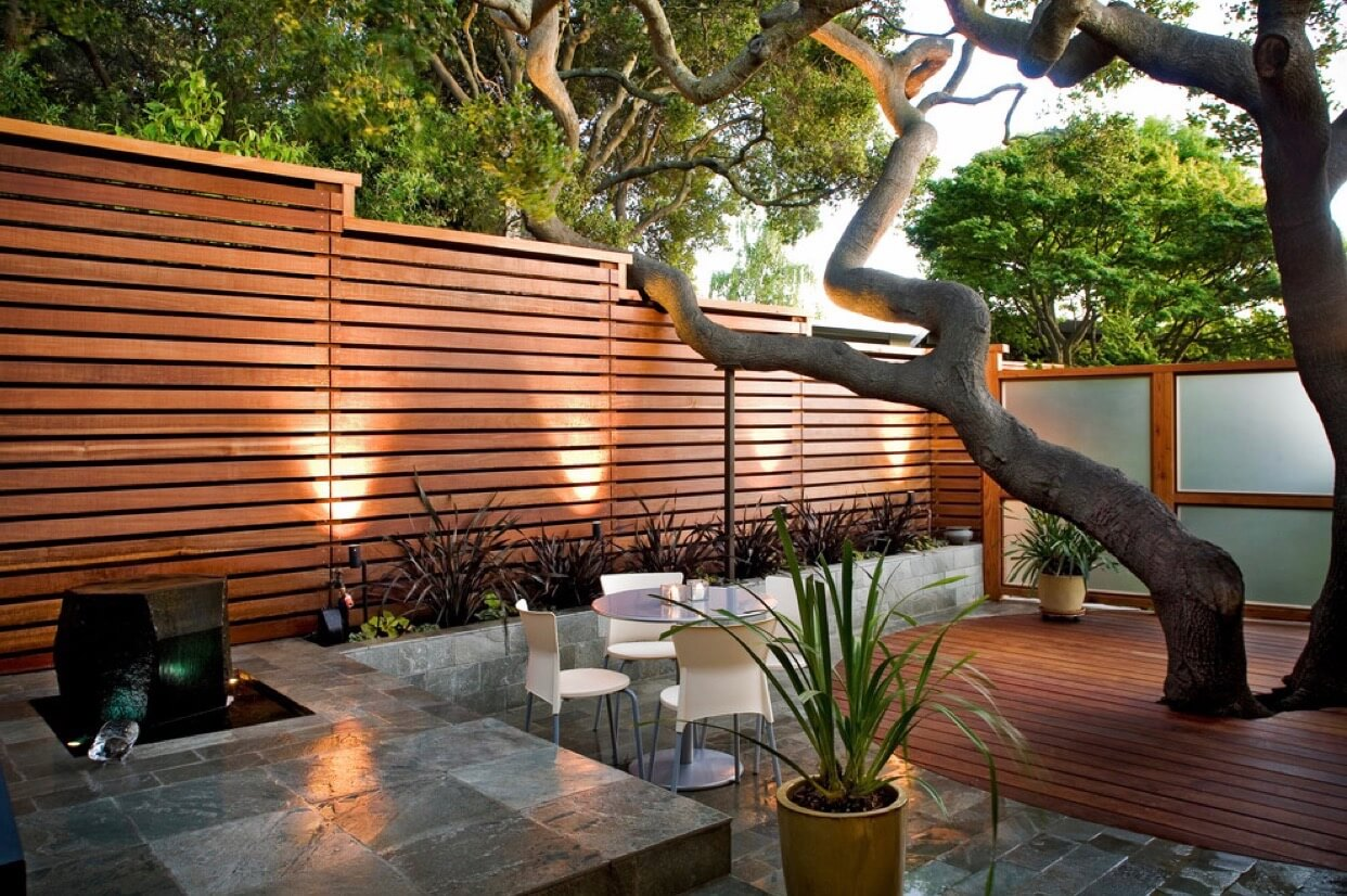 Take it up to the next level with a wooden privacy fence.