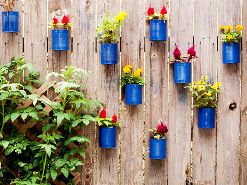 Add planters and some colorful flowers to make your fence pop.