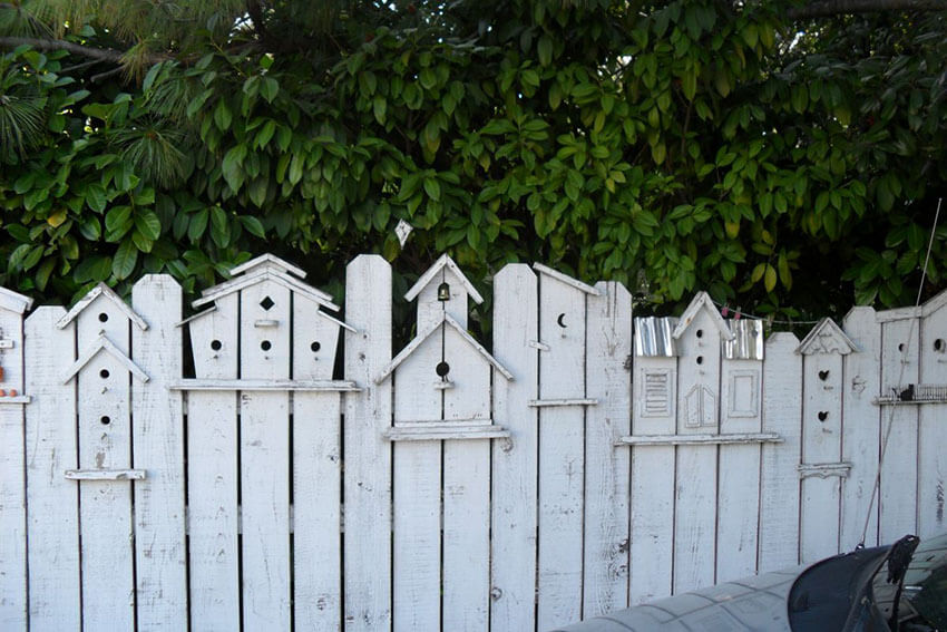 Attach birdhouses to decorate the fence and attract birds.