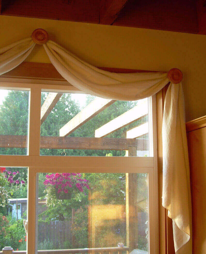 Hook curtains over your kitchen glass window
