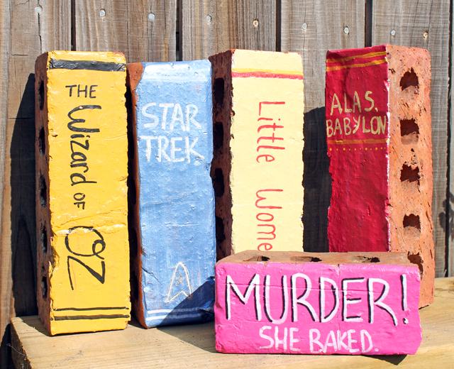 bricks painted like books in whimsical garden