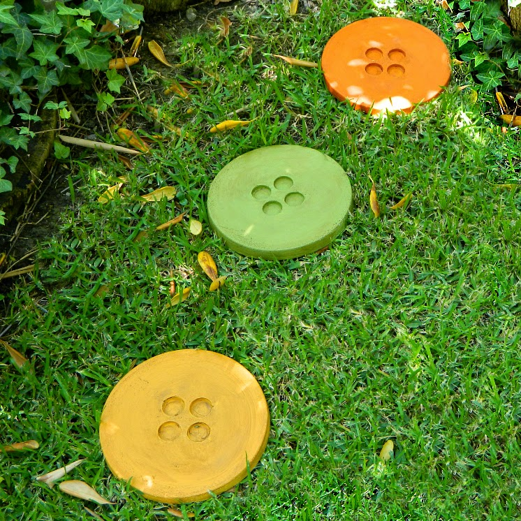 button-shaped stepping stones in whimsical garden