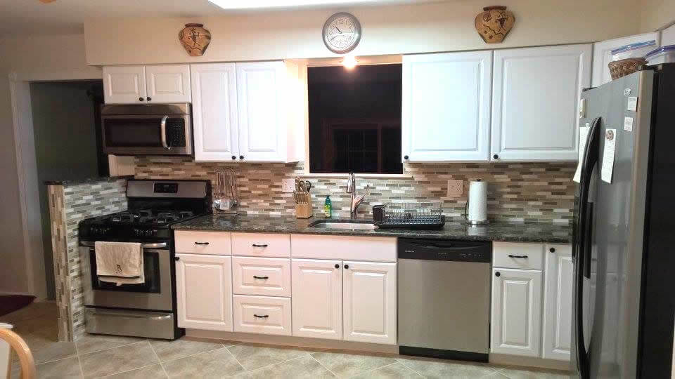 Brand new cabinets and countertops completely revamp the kitchen
