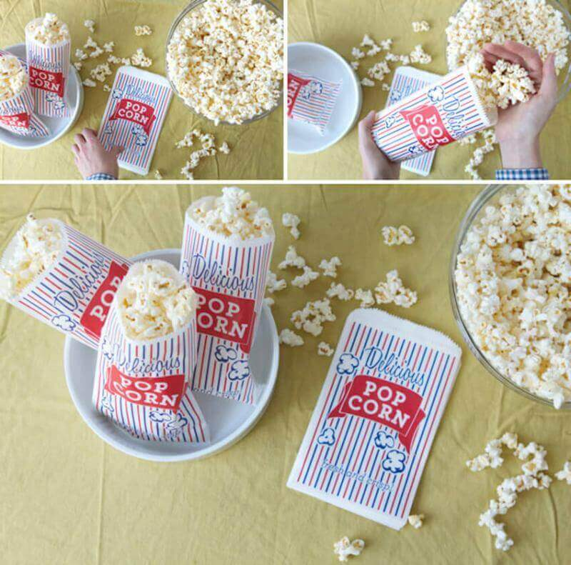 When you finish putting together your DIY outdoor movie theater, don't forget about snacks! A popcorn bar is a great way to let your guests choose how they want their popcorn!
