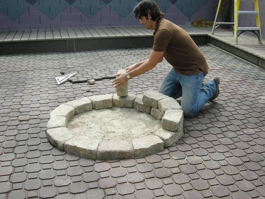 Cement patio pavers around the fire pit
