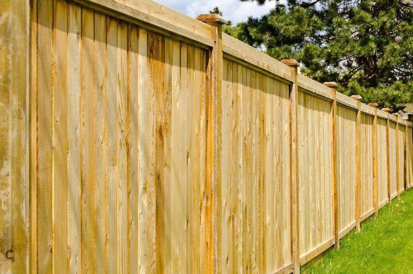 Wooden privacy fences for a home exterior