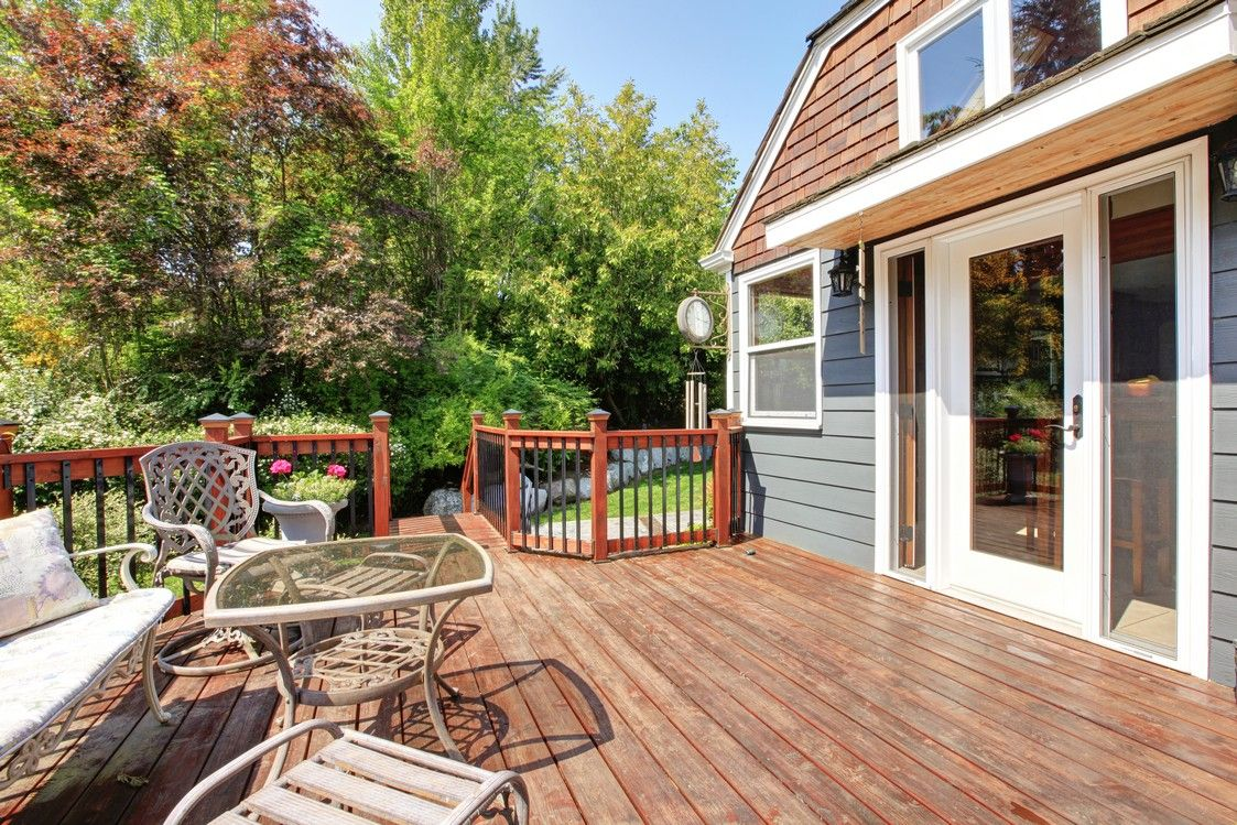 Sunrooms vs. Decks: Summer Exterior Installation Guide