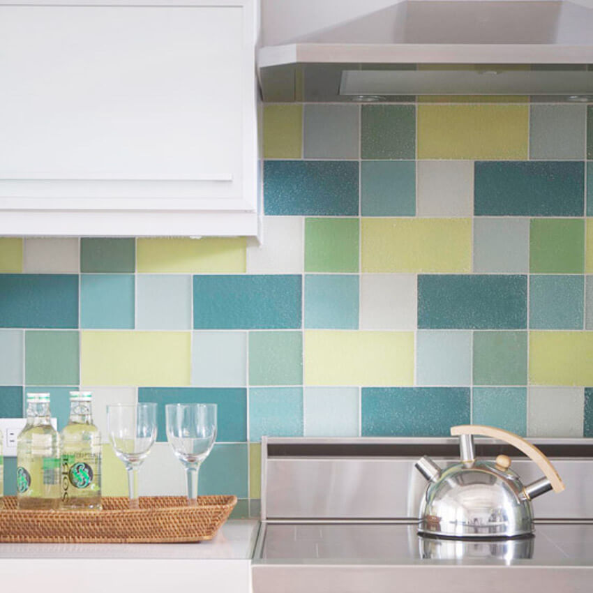 Blue, yellow, and green tiles made from recycled glass.