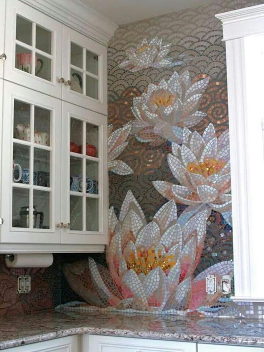 This flower mosaic is a beautiful addition to this kitchen.