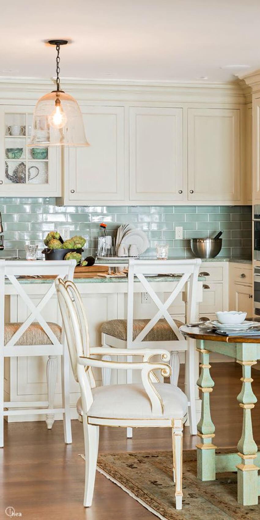 This blue translucent tile backsplash brings a pop of subtle color to this kitchen.