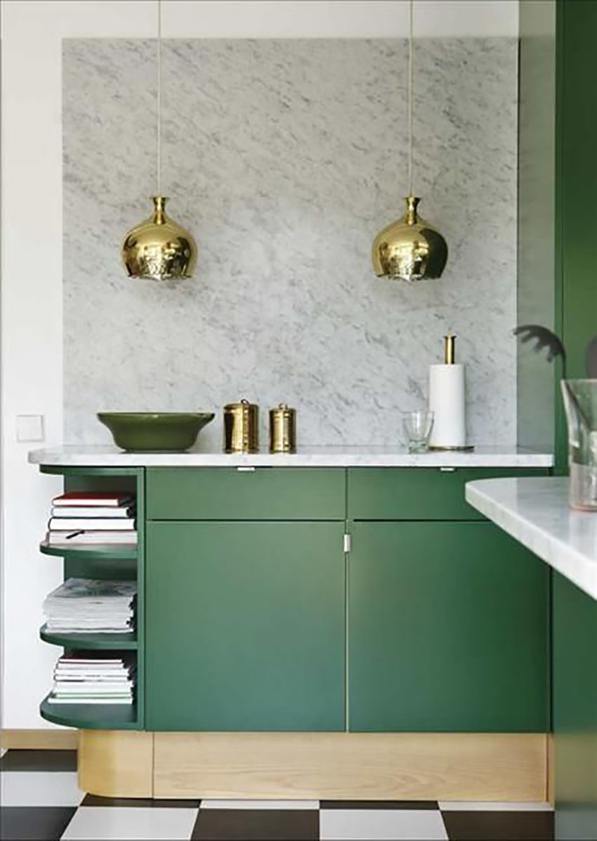 This bathroom with green cabinets and gold accents is a beautifully bold room.