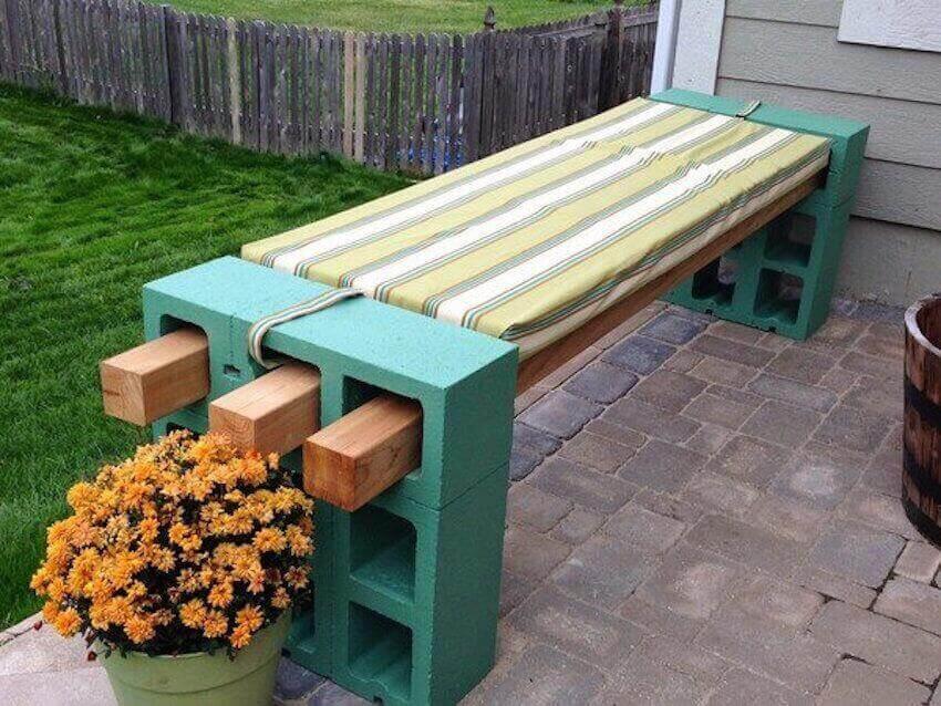 DIY garden bench with just wood beams and cinder blocks
