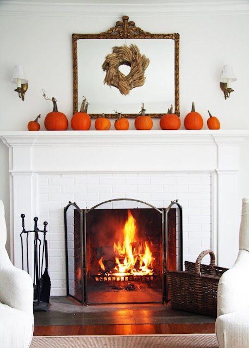 Pumpkin decor can line a mirror mantle