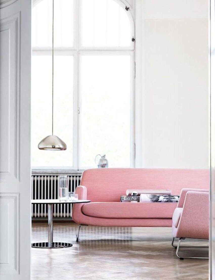Soft pink brings a pop of color to this minimalist living room.