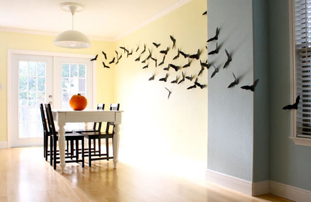 Have your kids help with the Halloween decorations by letting them cut out bats to hang on the wall.