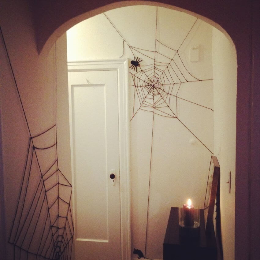 Make a super easy spooky spider Halloween decoration using yarn!