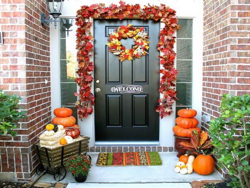 Front porch decor aligned with gourds