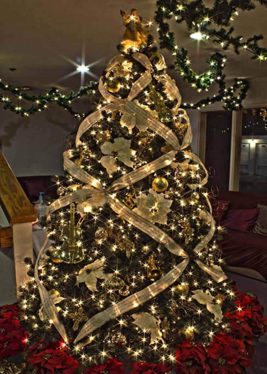 Indoor Christmas tree with lighting and tinsel