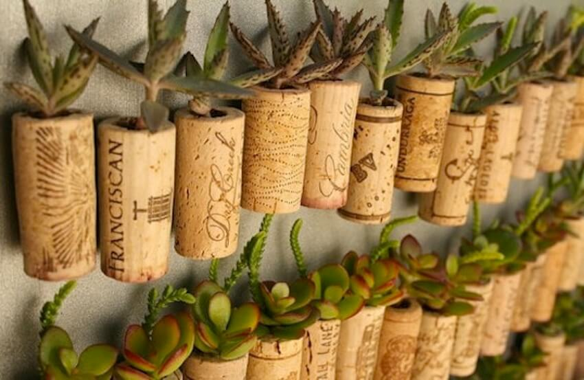 For small, unique planters, use wine corks and magnets to keep herbs close at hand.