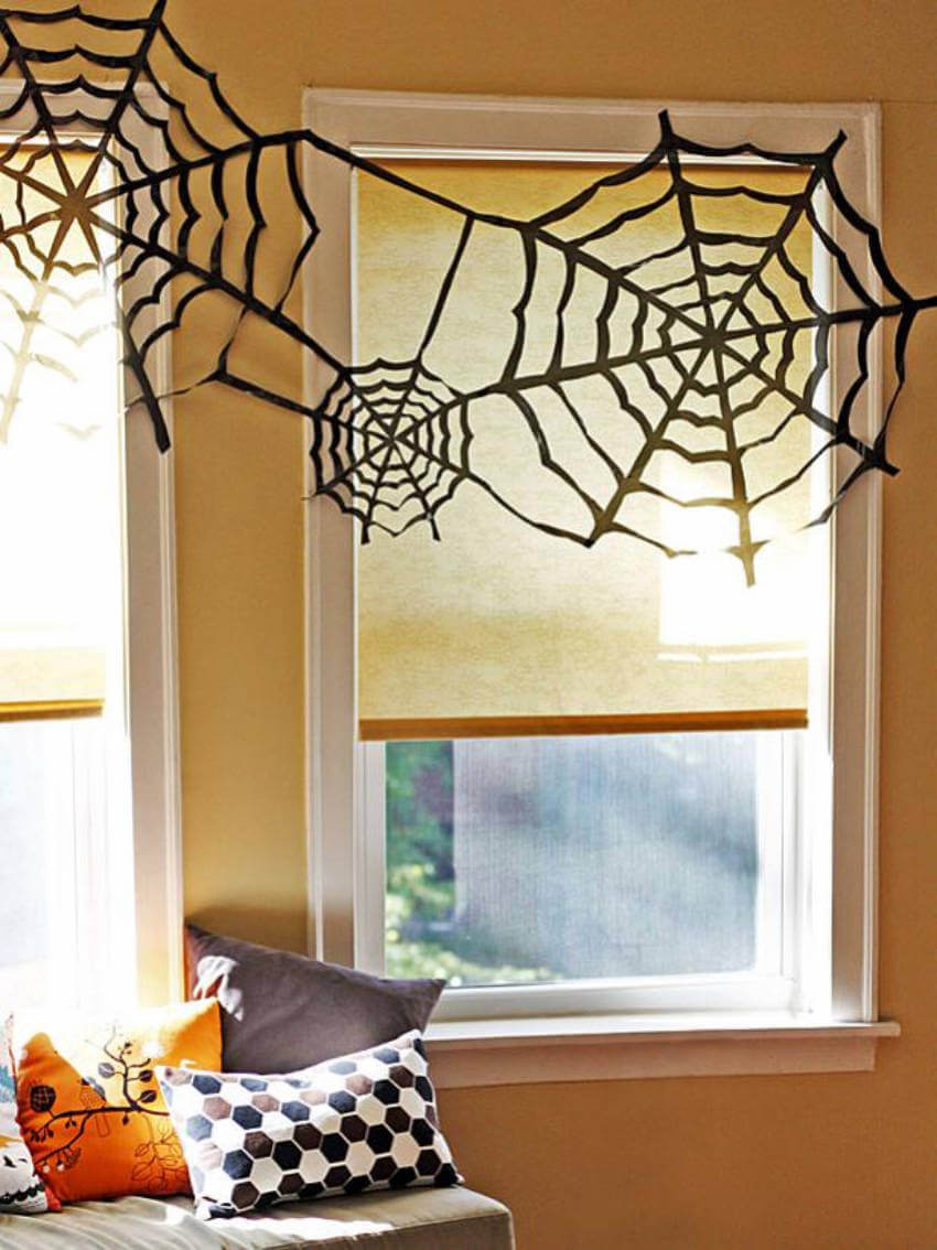 You can hang these faux spider webs over windows, on the staircase, or from the mantel!
