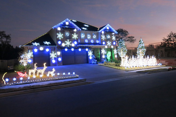 An interesting sight on Christmas night. Hire a pro or DIY. Image source www.houselogic.com/blog/lighting/gangnam-style-christmas-light-show-goes-silent/