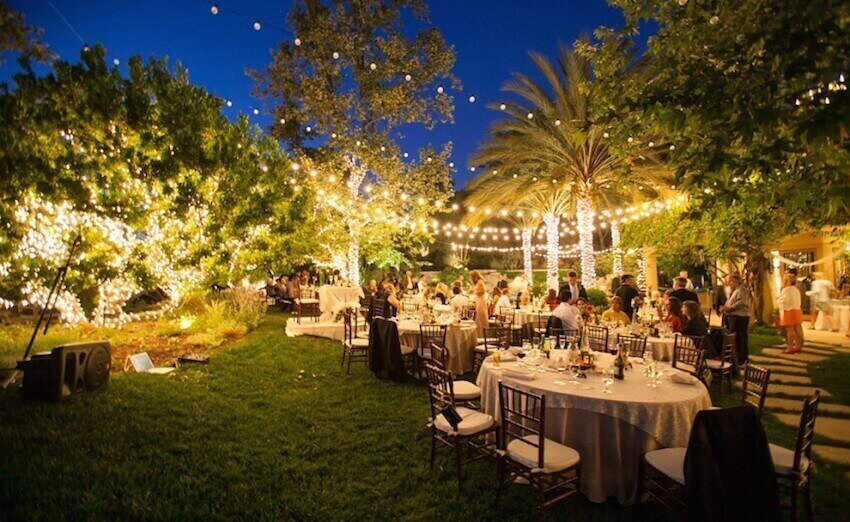 Using a backyard for a wedding is an amazing option, twinkle lights really brighten up the reception!