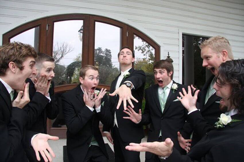 Check out that ring! Groomsman recreate a classic bridal party photo!