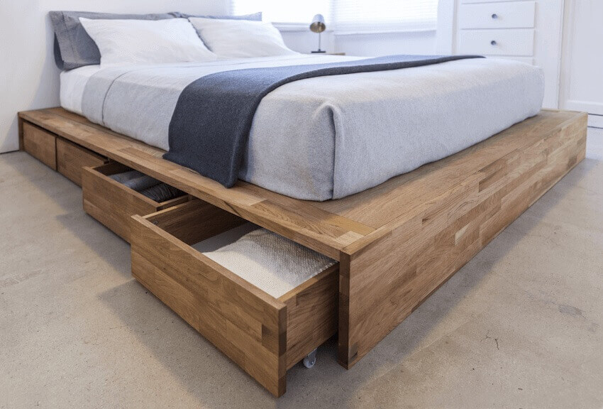 Having drawers under your bed is a great way to add storage space to a small bedroom.