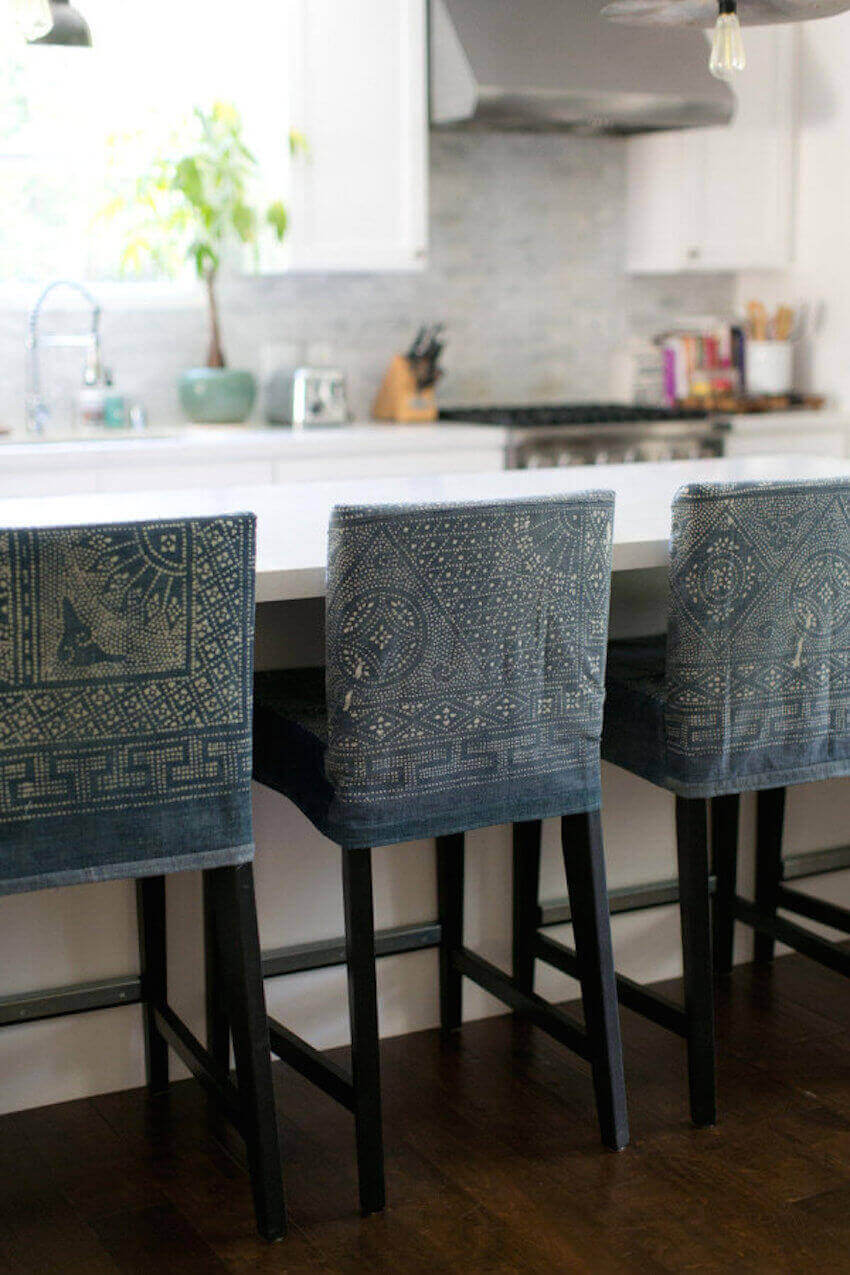 Make your own custom bar stool covers out of denim and a bleach pen.