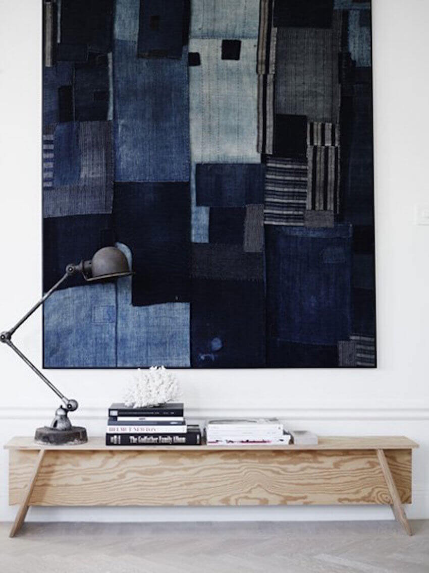 Use different colors of old denim jeans to create this awesome wall art.