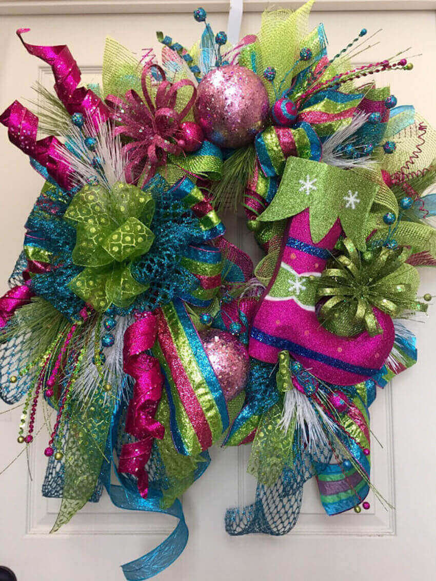 Festive holiday colors on an outdoor wreath