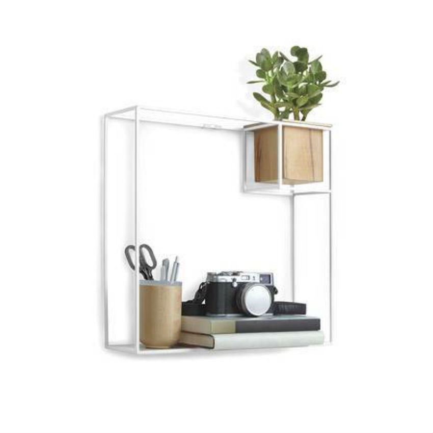 Transform any room with this stylish and functional wall shelf. Image Source: Domino