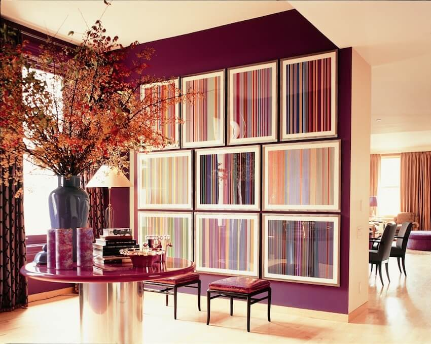 Matching furniture with the accent walls in a Fall reddish paint