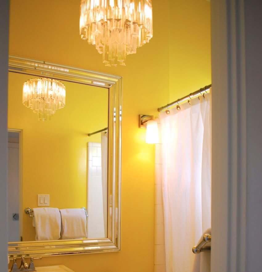 Yellow accent walls in a bathroom