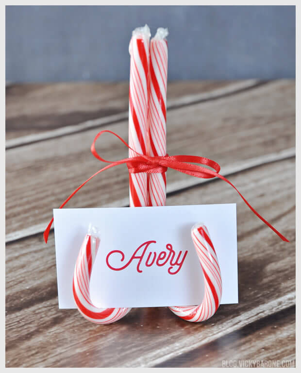 Dress up your holiday table by making these cute candy cane place cards!