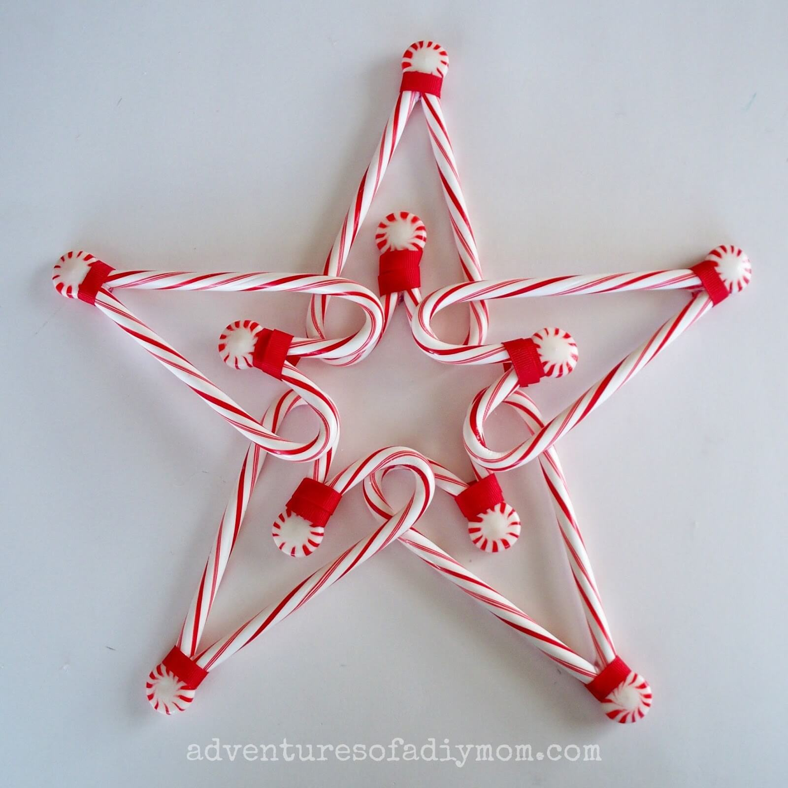 Get the kids involved in making this great DIY candy cane tree topper!