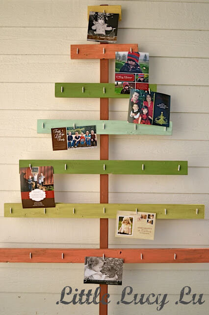 For a great way to display your Christmas cards, make this DIY Christmas tree card holder!