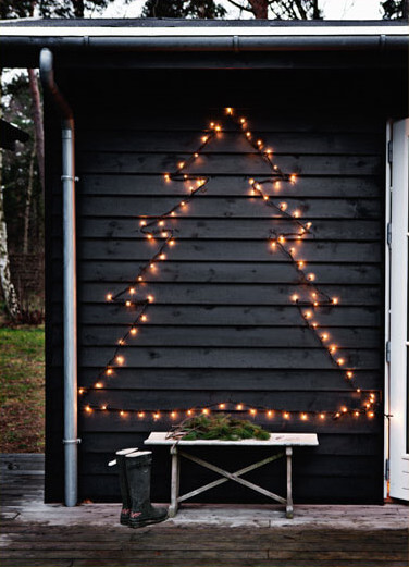Use a string of lights to make a pretty Christmas tree on your garage door or exterior wall!