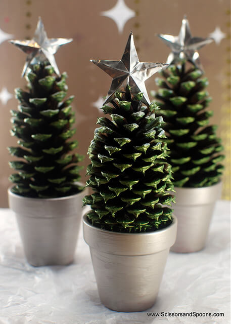 Instead of having one large tree, why not make a bunch of tiny pinecone Christmas trees?