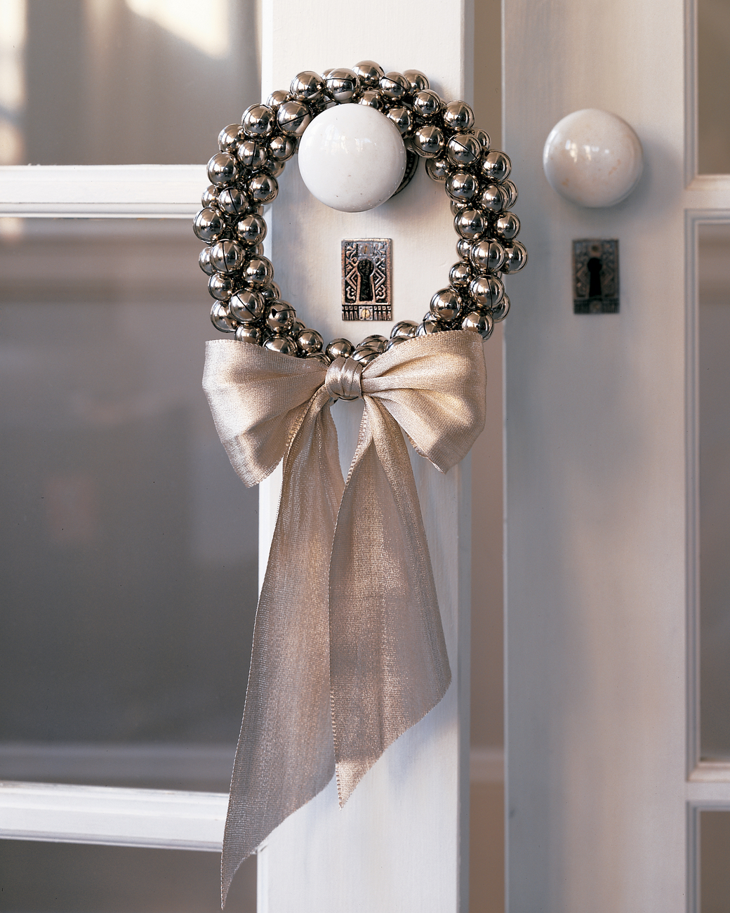 For a cute little wreath to hang on your doorknobs, make this DIY jingle bell wreath!