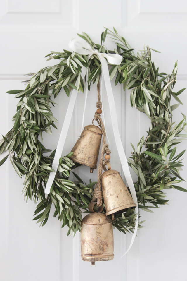 Use olive branches and bells to make a beautiful DIY wreath for your front door!