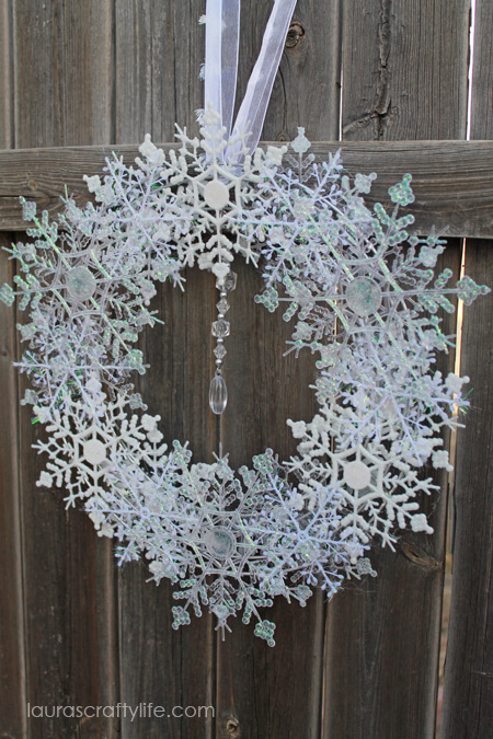 If you love snow, make this delightful snowflake wreath to hang on your door!