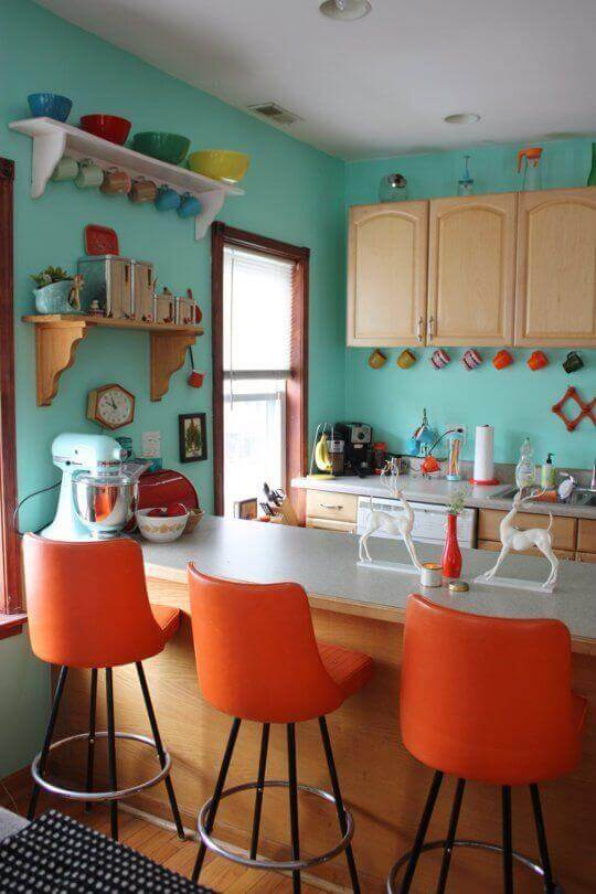 These teal walls are a great way to add color to your kitchen without being too bold.