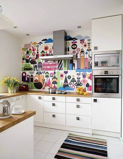 Get creative with your backsplash and use decals, paint, or tiles to add color to your kitchen!